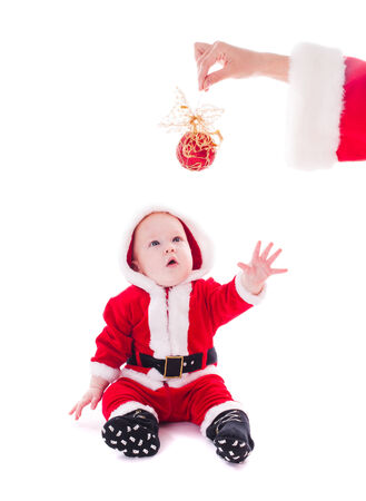 Little Santa boy wants to play isolated on white  photo