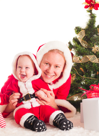 Christmas baby and mom under the fir tree photo