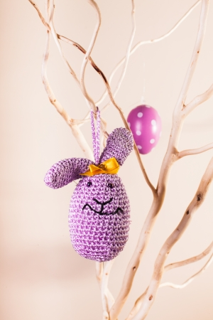 Handmade crochet easter decorations on the branches - bunny egg photo