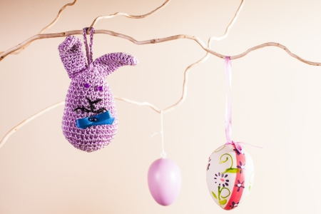 Handmade crochet easter decorations on the branches in vase photo