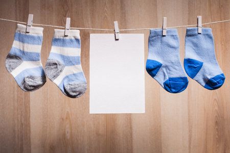 new born baby: Baby boy socks attached to the rope and blank card for greetings