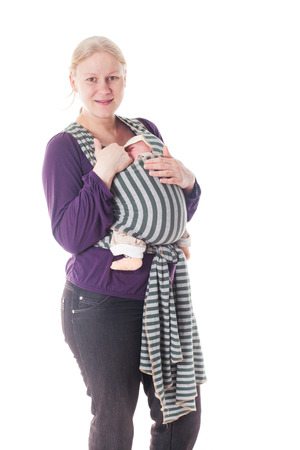 Mother with newborn baby in sling isolated on white photo
