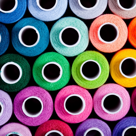 yarn: Sewing threads as a multicolored close up Stock Photo