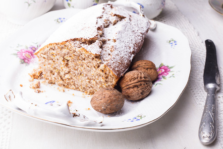 Walnut cake, piece on the plate, close up photo