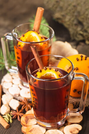 A mulled wine in the glass cup on wooden background photo