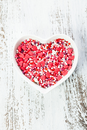 Sugar hearts in the plate - Valentine cake decorations photo
