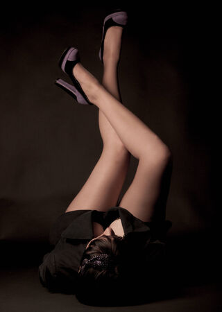 womans legs in the shoes on the black photo