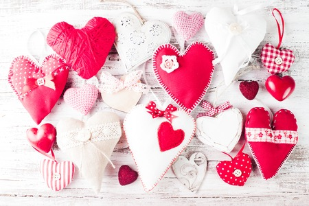 Valentine handmade hearts on the shabby wooden table photo