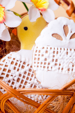 Easter cookies in basket over yellow background. Easter decor photo