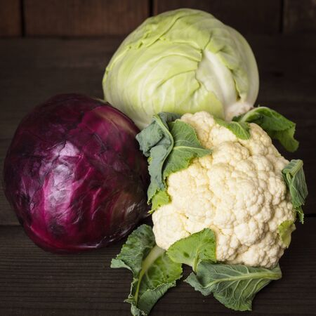 Cabbage types on the wooden table close up photo
