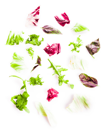 rocket lettuce: Heap of green healthy leaves salad on white Stock Photo