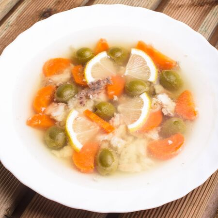 fatter: Sturgeon with lemon and carrot slices and green olives in aspic