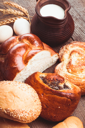 Types of homemade bread and jug with milk photo
