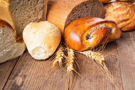 Types of homemade bread on the rustic wooden table photo