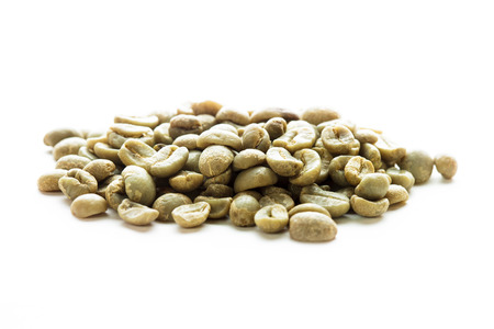 Green coffee beans heap isolated on white photo