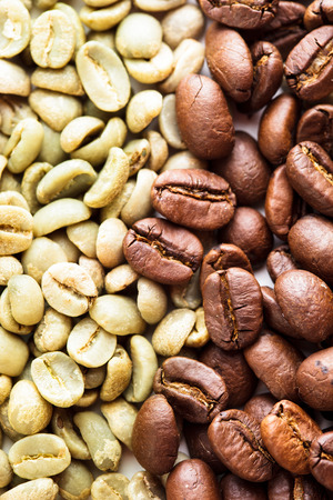 Black and green coffee beans as a background. Various types of coffee photo