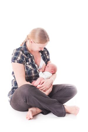 Mother breastfeeds her baby. Isolated on white photo