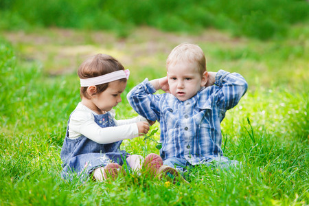 Little kids play outdoors on the grass Stock Photo - 27472575