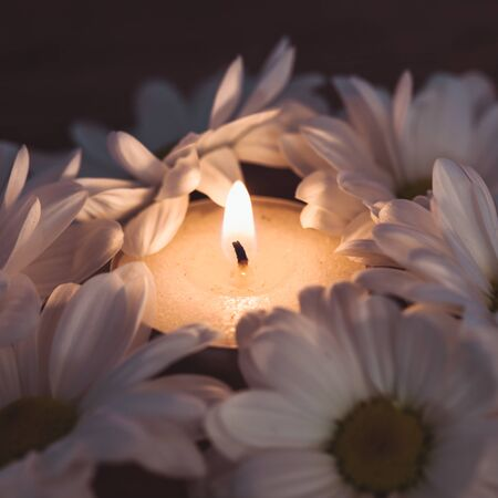 Candle and daisies - symbol of hygiene and spa photo