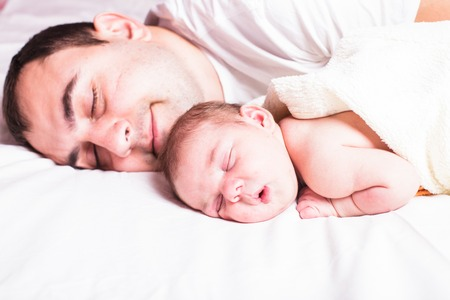 Baby sleeps with dad - tender care of his father photo