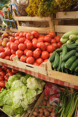 Summer fresh vegetables in boxes on the market photo