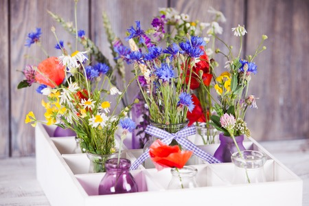 Wildflowers In Bottles In The Box. Kitchen Flowers Decor Stock Photo,  Picture And Royalty Free Image. Image 29491842.