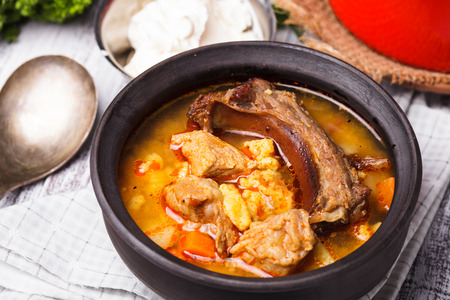 Traditional hungarian dish - bogracs goulash, stewed meat and vegetables in cauldron photo