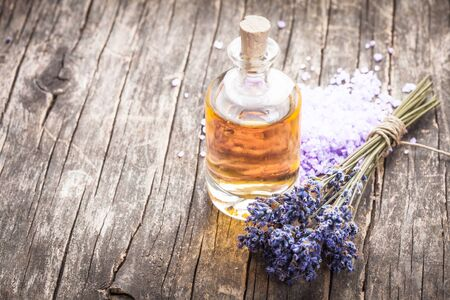 essential oil with lavender flower and seasalt - spa concept photo