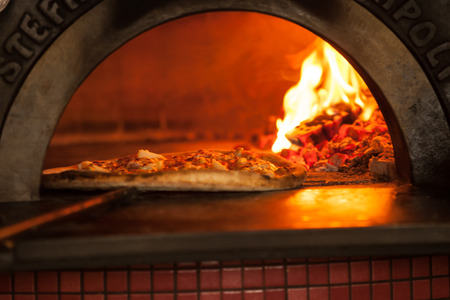 Pizza baking close up in the oven