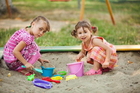 sandpit: Two girls play in the sandbox