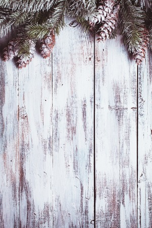 pinecones: White shabby Christmas border with snow covered pinecones