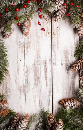 painted wood: White shabby Christmas border with snow covered pinecones