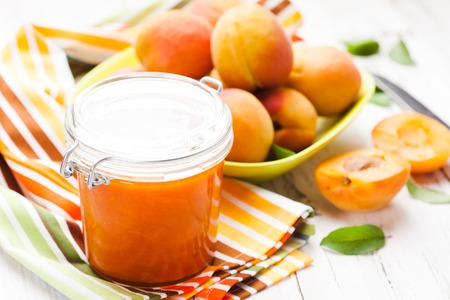 fleshy: Fleshy apricots in the bowl and fresh jam in a jar
