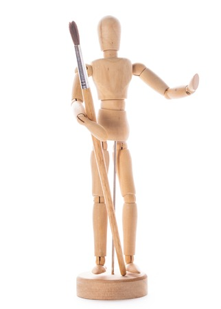 Art concept, wooden figure for modeling poses of human and paintbrush photo