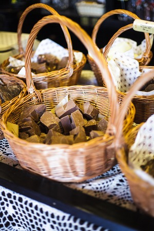 Chocolate shop. Pieces of natural product in baskets photo