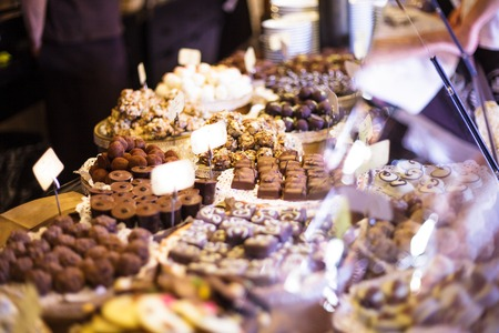 Chocolate candies on showcase in the store photo