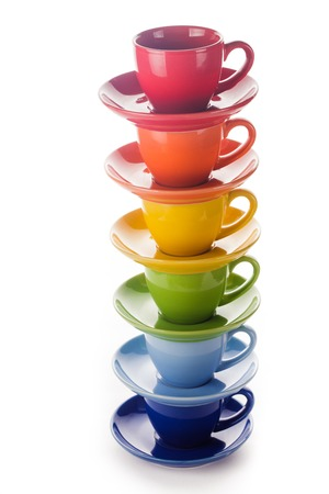 colourful rainbow cups isolated on a white photo
