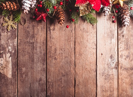 Christmas border design on the wooden background photo