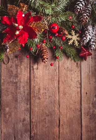 Christmas border design on the wooden background Foto de archivo