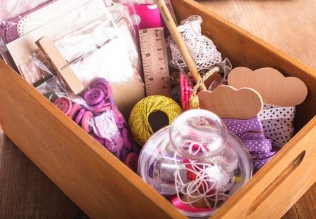 Scrapbooking craft materials in a wooden box
