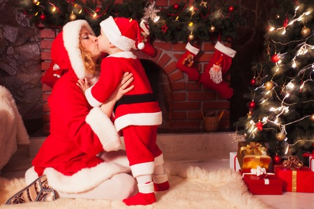 Mother and son in Christmas room photo