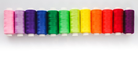 Sewing multicolored  threads isolated on a white