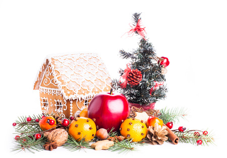 gingerbread house with christmas decorations on a white backgrond photo