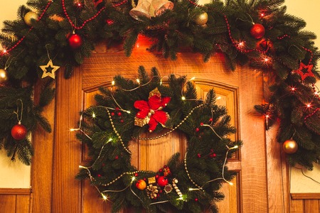 Christmas wreath with red sock and border on the door photo