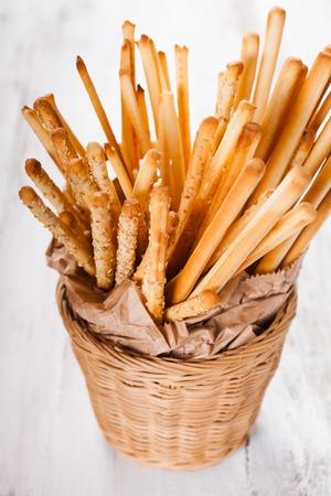 grissini: Different types of grissini breadsticks in a basket