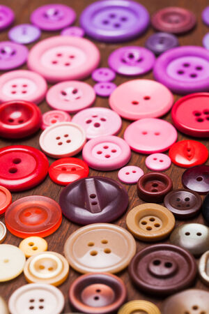 Colorful buttons as a rainbow background for design photo