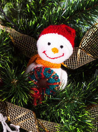 Knitted christmas  toys on the christmas tree photo