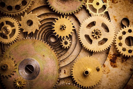 cog: Steampunk background from mechanical clocks details over old metal background. Inside the clock, gears Stock Photo