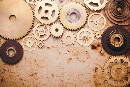 details: Steampunk background from mechanical clocks details over old metal background. Inside the clock, gears Stock Photo