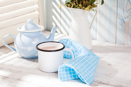 Morning cocoa cup on the kitchen table in shabby chic style photo